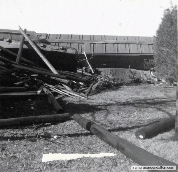 derailed boxcars and debris
